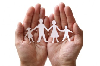 Image of hand holding a paper chian family
